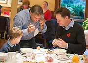 © Licensed to London News Pictures. 03/11/2014. Oxford, UK. RAYMOND BLANC (C) drops an egg as he shows NICK CLEGG (R) and local schoolboy Hugo Stone how to spot if it is safe to use a raw egg in cooking.  To celebrate National School Meals Week (3-7 November), the Deputy Prime Minister, Nick Clegg, joins school children at Brasserie Blanc in Oxford to get some top cooking tips from Raymond Blanc. The visit is part of a larger national effort to raise awareness of and enhance children's relationship with food. The Deputy Prime Minister has called on celebrity chefs to lead the way by joining forces with school cooks to promote the great school lunch. School cooks up and down the country will be taking their skills out of the school kitchen to showcase to parents and pupils the variety and quality of food now being served in schools. National School Meals Week comes just months after the launch of free school meals for 2.8 million primary school children and the introduction of cooking in the curriculum.. Photo credit : Stephen Simpson/LNP