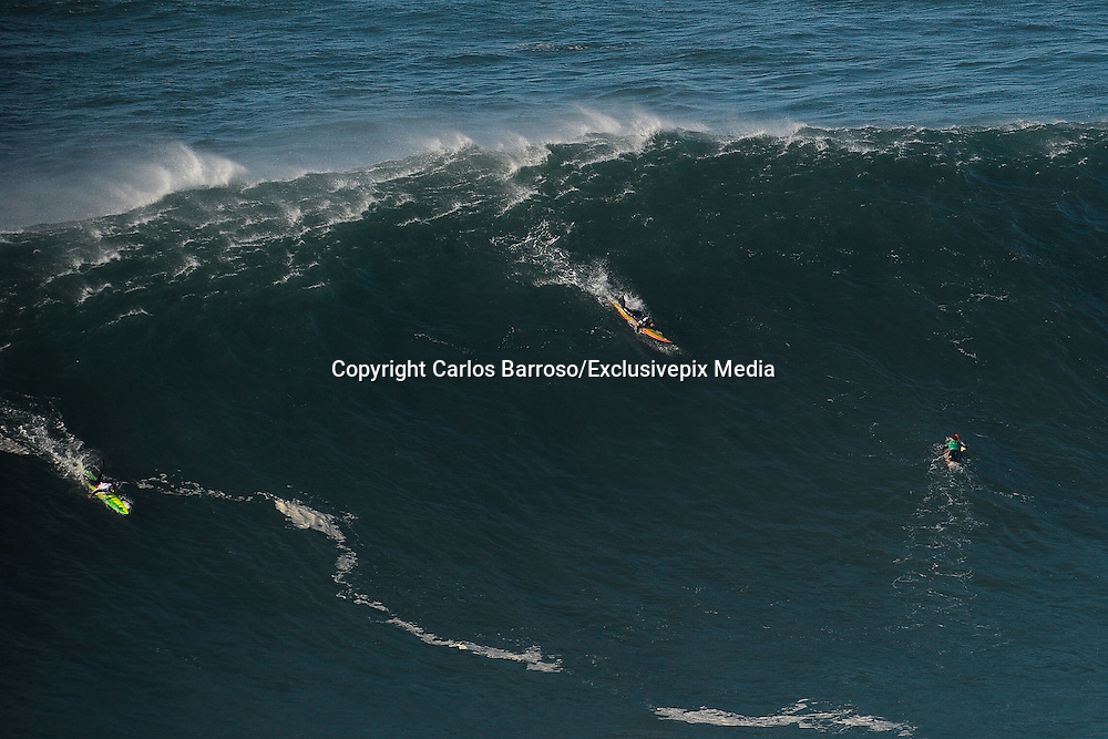 British Surfer Badly Injured during Surfing competition<br /> <br /> Sequence of images during the nazaré challenger's test on the northern beach in nazaré Portugal,  British surfer Tom Butler catches a giant wave on the northern beach falls and is seriously injured, he was taken to hospital<br /> <br /> Photo shows: British Surfer Tom Butler (orange surf board) catches a wave before being throw off and badly injured<br /> ©Carlos Barroso/Exclusivepix Media