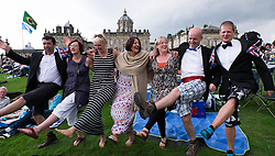 © Licensed to London News Pictures.22/08/15<br /> Castle Howard, North Yorkshire, UK. <br /> <br /> A group of friends dance to the music as hundreds of people attend the 25th anniversary of the Castle Howard Proms event near York. The theme of the event this year is a commemoration of the 75th anniversary of the Battle of Britain and the 70th anniversary of VE day and brings an evening of classic musical favourites celebrating Britishness to the lawns of Castle Howard.<br /> <br /> Photo credit : Ian Forsyth/LNP