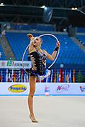 Volkova Ekaterina during qualifying at hoop in Pesaro World Cup 10 April 2015. Ekaterina was born in Vantaa, Finland, 1997. She is a Finnish individual rhythmic gymnast.