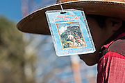A young cowboys wears his pass on his hat during the annual Cabalgata de Cristo Rey pilgrimage January 5, 2017 in Silao, Guanajuato, Mexico. Thousands of Mexican cowboys and horse take part in the three-day ride to the mountaintop shrine of Cristo Rey.