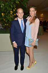 CARLO CARELLO and PHOEBE WATSON at a dinner hosted by Cartier in celebration of The Chelsea Flower Show held at The Hurlingham Club, London on 19th May 2014.