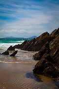 Rocks covered in mussels at Coumeenoole Beach, Slea Head, Dingle Peninsula, Kerry, Ireland
