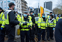 © Licensed to London News Pictures; 14/11/2020; Bristol, UK. Police at an Anti-Lockdown protest march and rally by Stand Up Bristol and StandUpX2, against the Covid-19 lockdown during the coronavirus pandemic. Protests have been declared illegal under the current Covid-19 lockdown as people are not allowed to meet in more than groups of two and police have threatened arrests and fines against those attending. Police arrested several people. The protest is against Lockdowns, Isolation of the Elderly, Ruined Childhoods, Business Closures, Masks, Government Interference in Private Life and is part of a series of protests today in Sheffield, Wolverhampton, Portsmouth, Bristol and Bournemouth. England is under a national lockdown, sometimes known as lockdown 2.0, as the UK Government tries to stop the spread of the covid-19 coronavirus pandemic. From 05 November lockdown restrictions came into force across England with all pubs, bars, restaurants and entertainment venues shut as well as all non-essential shops. People have been told to stay at home except for work, education, exercise or essential shopping and each person can only meet one other person from outside their household in an outdoors public space. Photo credit: Simon Chapman/LNP.