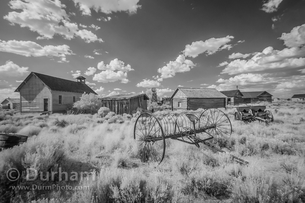 Old planter implement in the preserved town of Fort Rock. In 1988 the Fort Rock Valley Historical Society opened the Fort Rock Homestead Village Museum which preserves and protects homestead-era structures. The buildings were moved from their original locations to the museum site just west of the town of Fort Rock., Oregon. © Michael Durham