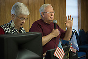 DURANT, OKLAHOMA - MARCH 24:  Vowell Posey leads the prayer before lunch at the Bryan County Retired Senior Volunteer Program in Durant, Oklahoma on March 24, 2017. (Photo by Cooper Neill for The Washington Post)