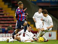Photograph: Scott Heavey.<br />Crystal Palace v Nottingham Forest. Nationeide Division One. 13/12/2003.<br />Wayne Routledge skips over the tackle from Des Walker