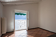 Empty room with a view of the lake on a spring day. Railing of the terrace in wrought iron.