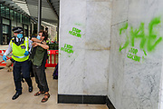 Police wearing face masks,  arrested a protestor after they allegedly sprayed 'STOP ECOCIDE' outside Shell Headquarters building in Jubilee Gardens, Central London, on Tuesday, Sept 8, 2020. Protestors are seeking to step up pressure on Shell and demand an end on fossil fuel extraction as well as ecocide. Environmental nonviolent activists group Extinction Rebellion enters its 8th day of continuous ten days protests to disrupt political institutions throughout peaceful actions swarming central London into a standoff, demanding that central government obeys and delivers Climate Emergency bill. (VXP Photo/ Vudi Xhymshiti)