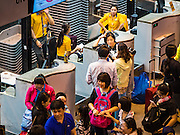 "23 FEBRUARY 2016 - BANGKOK, THAILAND:  Passengers in line to check for international flights on Nok Air at Don Mueang International Airport. Nok Air, partly owned by Thai Airways International and one of the largest and most successful budget airlines in Thailand, cancelled 20 flights Tuesday because of a shortage of pilots and announced that other flights would be cancelled or suspended through the weekend. The cancellations came after a wildcat strike by several pilots Sunday night cancelled flights and stranded more than a thousand travelers. The pilot shortage at Nok comes at a time when the Thai aviation industry is facing more scrutiny for maintenance and training of air and ground crews, record keeping, and the condition of Suvarnabhumi Airport, which although less than 10 years old is already over capacity, and facing maintenance issues related to runways and taxiways, some of which have developed cracks. The United States' Federal Aviation Administration late last year downgraded Thailand to a ""category 2"" rating, which means its civil aviation authority is deficient in one or more critical areas or that the country lacks laws and regulations needed to oversee airlines in line with international standards.        PHOTO BY JACK KURTZ"