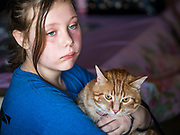 27 JUNE 2019 - CENTRAL CITY, IOWA: AVA LANGE, 11, and her cat, Ziggy, wait for the cat show to start at the Linn County Fair. Summer is county fair season in Iowa. Most of Iowa's 99 counties host their county fairs before the Iowa State Fair, August 8-18 this year. The Linn County Fair runs June 26 - 30. The first county fair in Linn County was in 1855. The fair provides opportunities for 4-H members, FFA members and the youth of Linn County to showcase their accomplishments and talents and provide activities, entertainment and learning opportunities to the diverse citizens of Linn County and guests.         PHOTO BY JACK KURTZ
