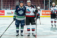 KELOWNA, BC - JANUARY 24: Conner Bruggen-Cate #20 of the Seattle Thunderbirds stands at centre ice with Matthew Wedman #20 of the Kelowna Rockets during warm up at Prospera Place on January 24, 2020 in Kelowna, Canada. (Photo by Marissa Baecker/Shoot the Breeze)