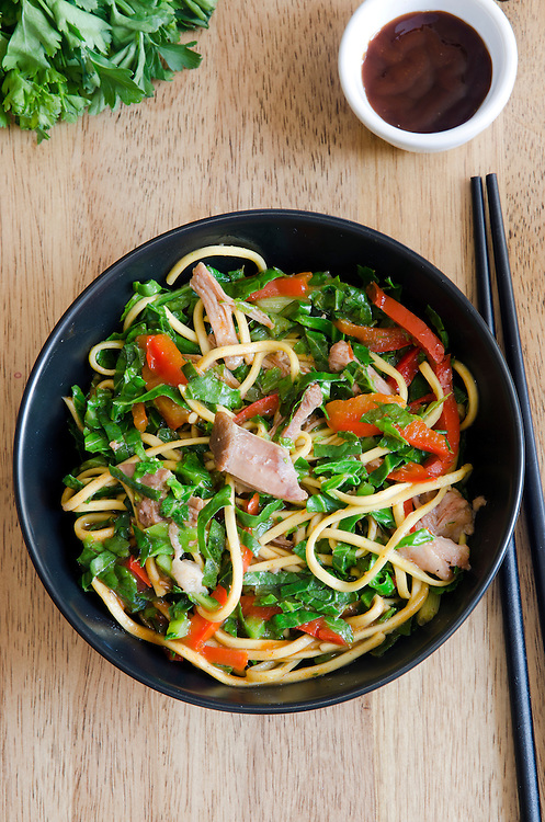 Sweet and aromatic pulled pork noodles in a bowl