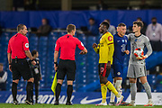 Danny Welbeck (Watford) thanking the officials with Kepa Arrizabalaga (GK) (Chelsea) & Ross Barkley (Chelsea) in the background following the Premier League match between Chelsea and Watford at Stamford Bridge, London, England on 4 July 2020.