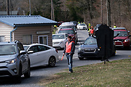 Cars line up as parishioners arrive for Bethany Wesleyan Church's Sunday worship service Mar. 22, 2020, at Becky's Drive-In in Walnutport, Pennsylvania. Concerns over the coronavirus have closed churches in an effort to avoid gatherings of large crowds.