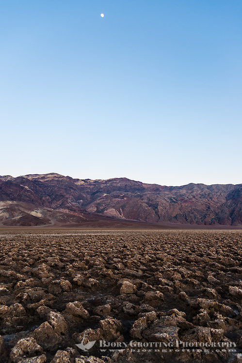 United States, California, Death Valley. The Devil's Golf Course is a large salt pan on the floor of Death Valley, with minerals left behind when the lake evaporated. Just after sunset.
