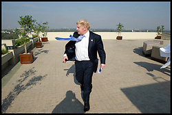 London Mayor Boris Johnson looks out over Delhi, on Day 2 of his 6 day tour, where he will be trying to persuade Indian businesses to invest in London, Monday November 26, 2012. Photo by Andrew Parsons / i-Images