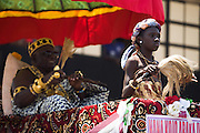 A local chief and a young girl sit in a palanquin carried by followers during the parade held on the occasion of the annual Oguaa Fetu Afahye Festival in Cape Coast, Ghana on Saturday September 6, 2008.