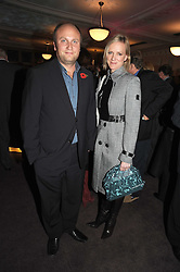 Actress HERMONIE NORRIS and her husband SIMON WHEELER at a party to celebrate the publication of 'Past Imperfect' by Julian Fellowes held at Cadogan Hall, 5 Sloane Terrace, London SW1 on 4th November 2008.