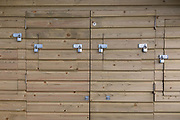The detail of the many padlocks on the exterior of a wooden beach hut, on 31st March 2019, in Whitstable, Kent, England.