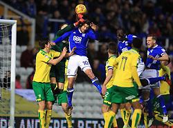 Birmingham City's Lukas Jutkiewicz (centre) and Norwich City's goalkeeper Angus Gunn battle for the ball