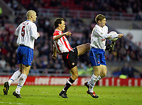 SATURDAY 3RD JANUARY 2004<br /> SUNDERLAND V HARTLEPOOL FA CUP 3RD ROUND<br /> PIC SCOTT HEPPELL-SPORTSBEAT IMAGES<br /> JOACHIM BJØRKLUND KICKS THE BALL AS EIFION WILLIAMS JUMPS AND HANDLES THE BALL IN THE PROCESS