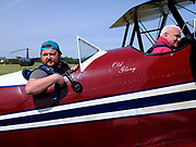 Pilot returning from taking a friend for a ride in his N3N.