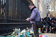 A member of the public stands in silence and prays In memory of Prince Philip The Royal Highness the Duke of Edinburgh, London on 9 April 2021.