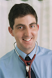 Portrait of doctor wearing stethoscope around neck smiling,