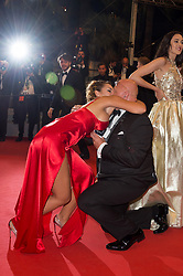 A guest proposes (wedding proposal) to his companion on the red carpet as they arriving on the red carpet of 'Mektoub, My Love : Intermezzo' screening held at the Palais Des Festivals in Cannes, France on May 23, 2019 as part of the 72th Cannes Film Festival. Photo by Nicolas Genin/ABACAPRESS.COM