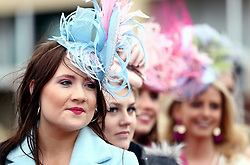Female racegoers takes part in the Miss Cheltenham finalists line up during Ladies Day of the 2018 Cheltenham Festival at Cheltenham Racecourse.