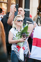 An EDL (English Defence League) organised event to lay flowers at Barkers Pool War Memorial Sheffield,  in memory of Drummer Lee Rigby, resulted in a two hour stand off when Sheffield Unite Against Fascism and One Sheffield Many Cultures supporters occupied Barkers Pool and surrounded the War Memorial leaving police to keep the opposing factions apart. <br /> A female EDL support waits at the police Cordon with flowers and coffee<br /> 1 June 2013