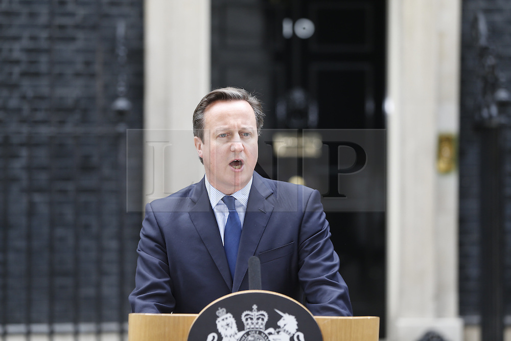 """© Licensed to London News Pictures. 13/11/2015. London, UK. Prime Minister David Cameron giving a statement about British terrorist dubbed as """"Jihadi John"""" in Downing Street on Friday, 13 November 2015. Photo credit: Tolga Akmen/LNP"""