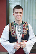 Young man in traditional local folk costume, a member of the KUD Veselin Maslesa Folklore Ensemble, Banja Luka, Bosnia and Herzegovina (11 April 2014). KUD Veselin Maslesa is the leading folklore ensemble in Bosnia and Hercegovina, with the country's largest collection of authentic folk costumes, and has won numerous awards. © Rudolf Abraham