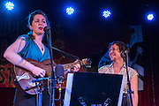 Mamie Minch and Tamar Korn (left to right) singing  at the Brooklyn Follk Festival. The duo included songs from the jazz era in their set.