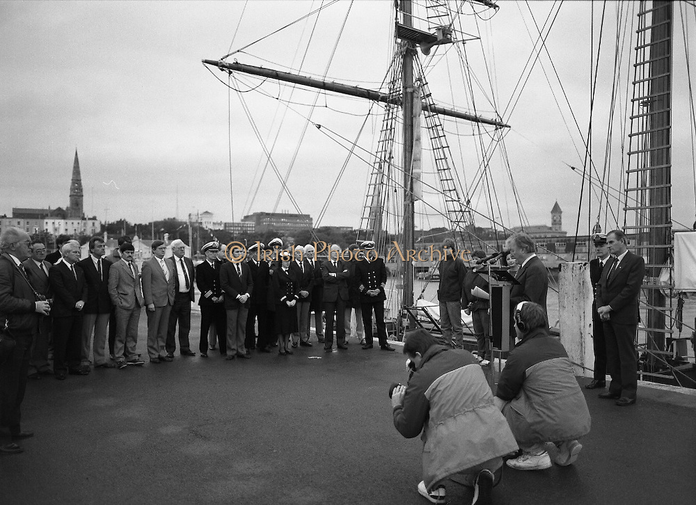 Asgard II departs for Australia.   (R66)..1987..15.10.1987..10.15.1987..15th October 1987..The Asgard II training ship departed from the National Yacht Club in Dun Laoghaire en route to Australia. The Asgard II was a purpose built training brigantine built by Jack Tyrrell in Wicklow. On hand to sent the Asgard Ii on her way was An Taoiseach, Mr Charles Haughey, and Mr Frank Milne the Australian Ambassador to Ireland...A view of the dignitaries and crew members listening to the speech being given by An Taoiseach, Charles Haughey TD. The media are shown moving in for their close ups.