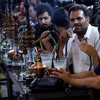 Men smoking in a cafe of Isphahan.