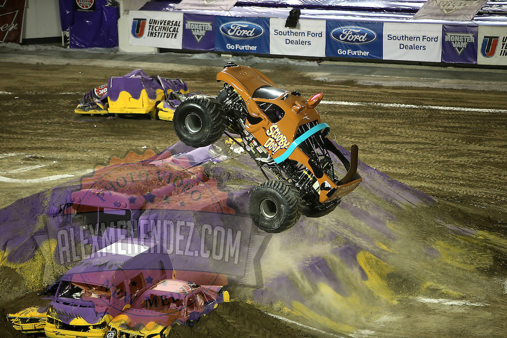 Scooby-Doo driven by Nicole Johnson is seen during the Monster Jam big truck event at the Citrus Bowl in Orlando, Florida on Saturday, January 25, 2014. (AP Photo/Alex Menendez)