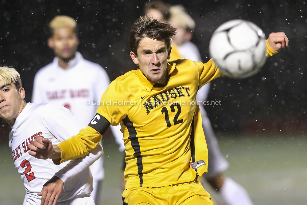 (11/17/19, MILFORD, MA) Nauset's Spencer Rushnak  takes control of the ball during the Division 2 South sectional finals against Milford at Milford High School on Sunday. [Daily News and Wicked Local Photo/Dan Holmes]