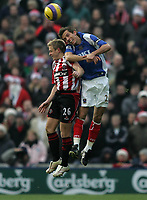 Photo: Lee Earle.<br /> Portsmouth v Sheffield United. The Barclays Premiership. 23/12/2006. Portsmouth's Gary O'Neil (R) battles with Derek Geary.
