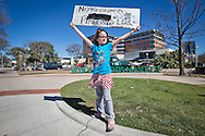 Austin, Texas, February 17th, 2013,<br /> Zelda Maples, 7 holds a 3-demential sign with a pipeline made out of empty toilet papers on it illustrating a leaking pipeline in front of  an Austin's Whole Foods store before a protest with<br /> over 300 protester against the Keystone XL Pipeline begins. The protest in Austin was in solidarity with The protest in<br />  Washington DC where tens of thousands showed up for the largest climate change rally protest in the environmental movement's history.  A coalition of environmental groups took place in the actions including , the Sierra Club, 350.org, and the Tar Sands Blockade.