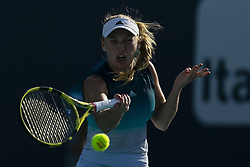 March 25, 2019 - Miami Gardens, FL, USA - Caroline Wozniacki, of Denmark, returns a shot to Hsieh Su-wei, of Taiwan, during their match at the Miami Open tennis tournament on Monday, March 25, 2019 at Hard Rock Stadium in Miami Gardens, Fla. (Credit Image: © Matias J. Ocner/Miami Herald/TNS via ZUMA Wire)