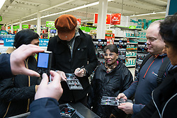 © Licensed to London News Pictures . 08/12/2014 . Manchester , UK . SIR BOB GELDOF (in brown hat) signing CDs at a branch of Asda in Trafford Park , Manchester , this morning ( 8th December 2014 ) for the CD launch of Band Aid 30 . Photo credit : Joel Goodman/LNP