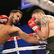 Jose Lopez (L) fights Daniel Lopez during a Telemundo boxing match between at Osceola Heritage Park on Friday, February 23, 2018 in Kissimmee, Florida.  (Alex Menendez via AP)