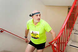 © Licensed to London News Pictures. 01/03/2012. LONDON, UK. Paul Smith, 40, attempts to run the world's first 'vertical mile' today by racing up the 920 steps of Tower 42 nine times at Vertical Rush, Shelter's tower running event in the City of London. Today (01/03/12) a host of celebrities joined 1,200 people to run up the 920 steps of Tower 42, raising £250,000 for housing charity Shelter. Now in its fourth year, the award-winning Vertical Rush will once again take place at London's original skyscraper, Tower 42. Photo credit: Matt Cetti-Roberts/LNP© Licensed to London News Pictures. 01/03/2012. LONDON, UK. CAPTION HERE. Photo credit: Matt Cetti-Roberts/LNP