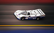 Image of Bruce Leven driving his blue and white Bayside Racing Porsche 962 at Rennsport Reunion III at Daytona International Speedway in Daytona, Florida, America Southeast