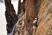 James McHaffie leading the crux 8b pitch of the Voie Petit, Grand Capucin, Mont Blanc range