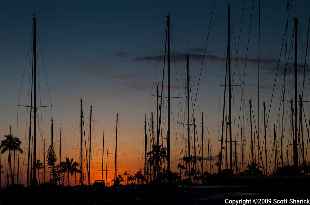 A beautiful sunset showing the mast of the boats in Waikiki Boat Harbor on the island of Oahu in Hawaii.