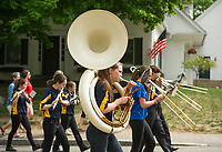 Stevie Orton on the Tuba marches with the Gilford Community Band to Gilford Cemetery during the Memorial Day parade and services Monday morning.  (Karen Bobotas/for the Laconia Daily Sun)