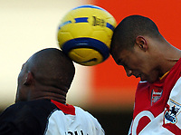 Photo: Javier Garcia/Back Page Images<br />Arsenal v Fulham, FA Barclays Premiership, Highbury, 26/12/04<br />Gael Clichy deals with the aerial threat from Collins John